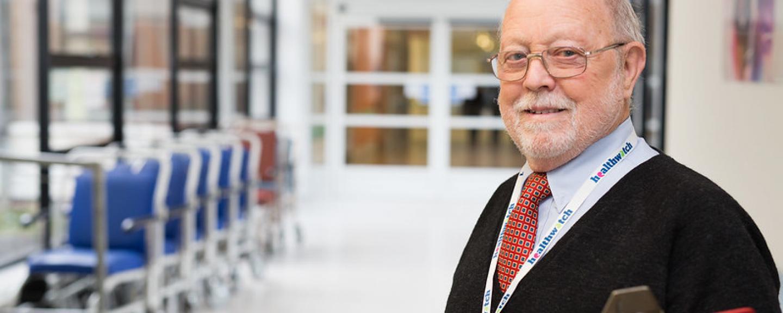 Man stood in a hospital corridor