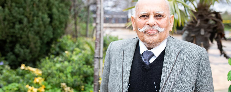 Elderly gentleman standing in a courtyard