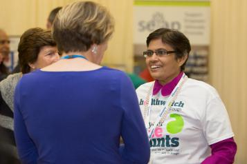 Healthwatch volunteer talking to a woman