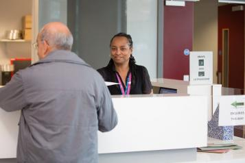 Receptionist talking to a member of the public