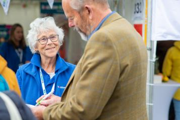 Healthwatch volunteer talking to a man