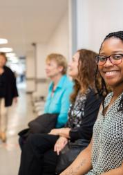 Woman smiling waiting in a hospital